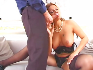 Big tittied lusty mommy blows sweet lollipop of her young stud