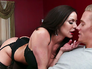 Attractive dark haired MILF has sex with the younger man