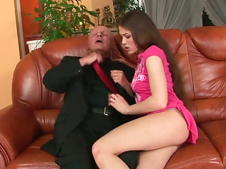 Cute brownhead babe with perky tits is giving a head to old daddy