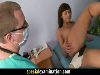 A girl with dragon tattoo examined by gynecologist