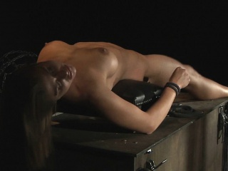 Tied by a pole bridge and hard bodily whipped