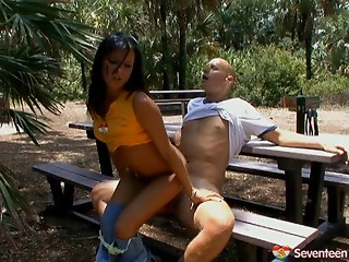 Legal age teenager playgirl bent over a picnic table and drilled from behind