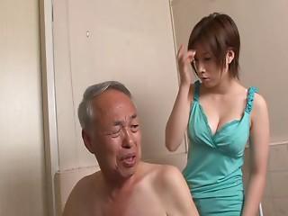 Salacious Asian chick with nice big tits sucking an old man's cock