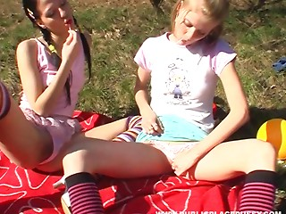 Playful legal age teenagers in a grassy field love the smack of love tunnel