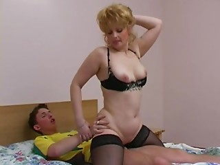 Lascivious elder Russian woman fucking a young slut stud in a soccer jersey