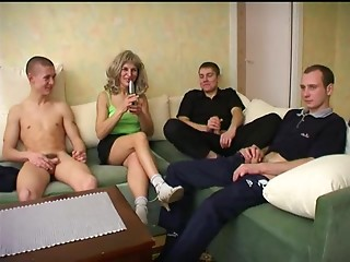 A group of younger chaps gangbangs a horny, horny old slut