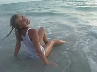 Dilettante golden-haired legal age teenager naively positions in Soaked T-shirt on the beach