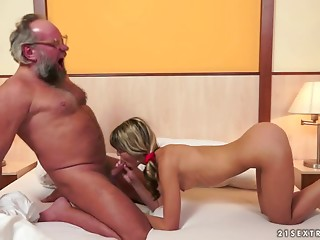 Older stud in glasses copulates astounding Doris Ivy on a ottoman