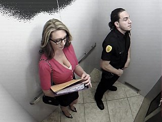 Big breasted office angel engulfing security guard in elevator