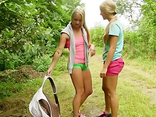 Frisky lesbo cuties have vehement sex in the nature